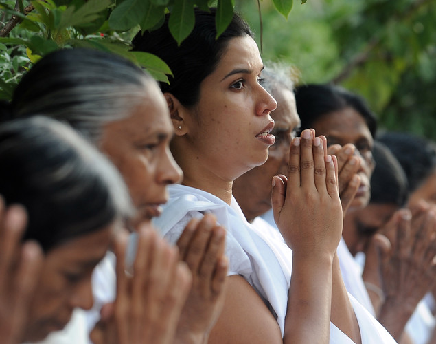Sri Lankan devotees pray at a Buddhist shrine in observation of Vesak at the Temple in Colombo.