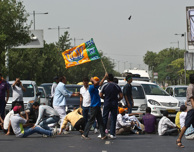 Bharatiya Janata party (BJP) activists block a road during a protest against a petrol price hike in New Delhi.