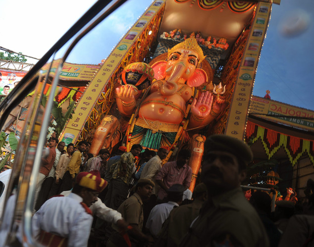 The reflection of a 58-foot (17.57 meter) tall idol of the Hindu god Lord Ganesh, popularly known as 'Khairatabad Ganesh', is seen on a vehicle window during the festival of 'Ganesh Chaturthi' in Hyderabad.