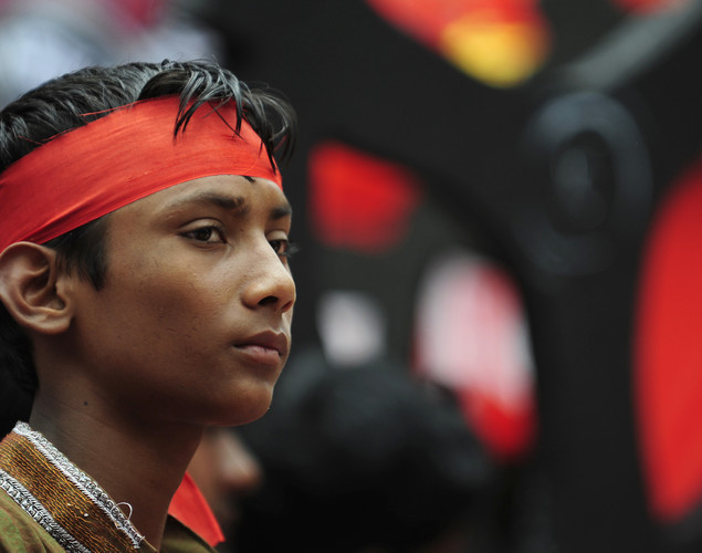 A Bangladeshi activist attends a procession to mark May Day or International Workers Day in Dhaka.