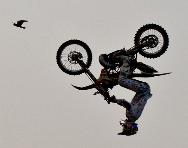 A Freestyle Motocross (FMX) RedBull X-Fighters rider performs at the India Gate in New Delhi.