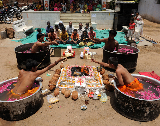 Indian Hindu Brahmins perform the ceremony.