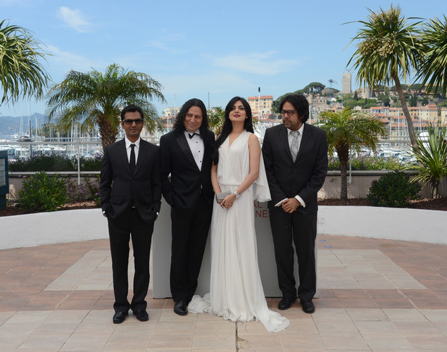 Nawazuddin Siddiqui, Anil George, Niharika Singh and Indian director Ashim Ahluwalia pose during the photocall of 'Miss Lovely' presented in the Un Certain Regard selection at the 65th Cannes film festival.