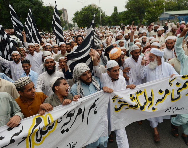 Pakistani activists of Jamiat Ulma e Islam shout slogans during a rally against an anti-Islam movie in Islamabad.