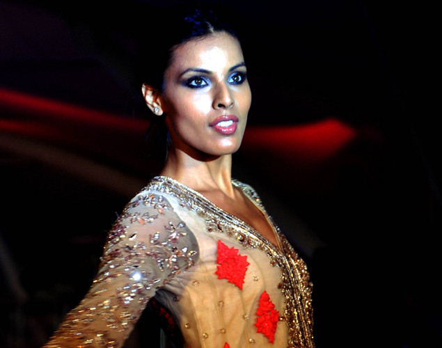 Indian model Deepti Gujral walks the ramp during the seventh annual Pidilite-CPAA Charity Fashion Show showcasing designers Manish Malhotra and Shaina NC in support of the Cancer Patients Aid Association.