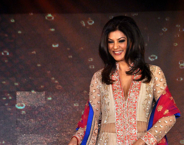 Sushmita Sen walks the ramp  displaying creations by designer Manish Malhotra for a public awareness campaign Save and Empower the Girl Child in Mumbai late April 11, 2012.