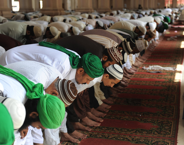 Pakistani Muslims offer Jummat-Ul-Vida prayers on the last Friday of Ramadan in Karachi.