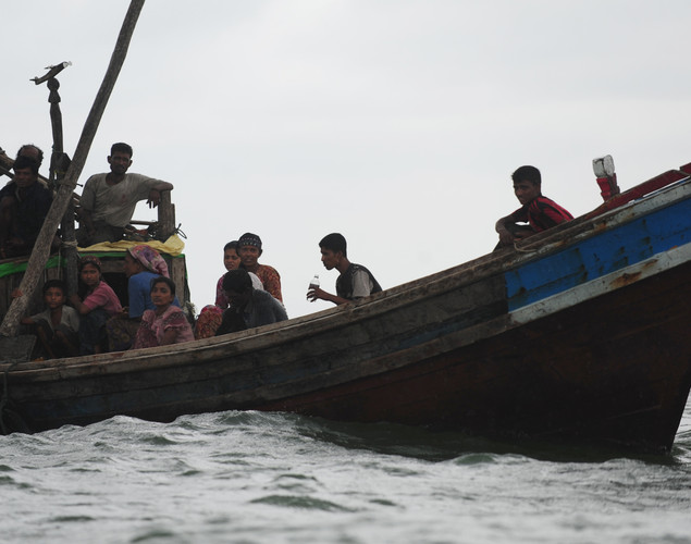 A boat transporting Rohingya Muslims, fleeing sectarian violence in Myanmar, is intercepted while trying to cross the Naf river into Bangladesh in Teknaf.