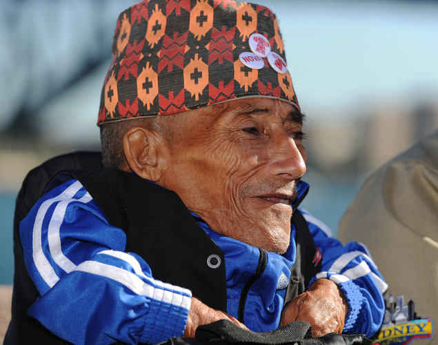 Chandra Bahadur Dangi, the 72-year-old Nepali crowned the 'world's shortest man' by Guinness World Records, smiles during a press conference at Circular Quay on Sydney Harbour at the start of a week of promotional engagements.