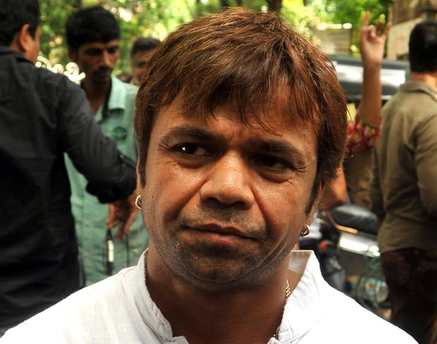 Bollywood actor Rajpal Yadav attends the cremation ceremony of late Indian actor Dara Singh in Mumbai.