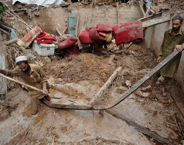 Flash floods and landslides triggered by heavy rain have killed at least 26 people and destroyed hundreds of houses in northern Pakistan last month, officials said.