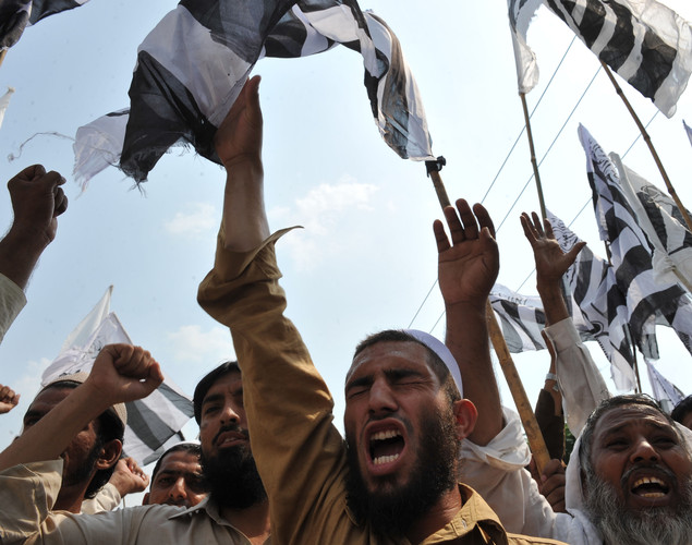 Activists of Jamaat-ud-Dawa Pakistan shout slogans during a rally following congregational Friday prayers in Islamabad to denounce the resumption of NATO supplies from the country into Afghanistan.