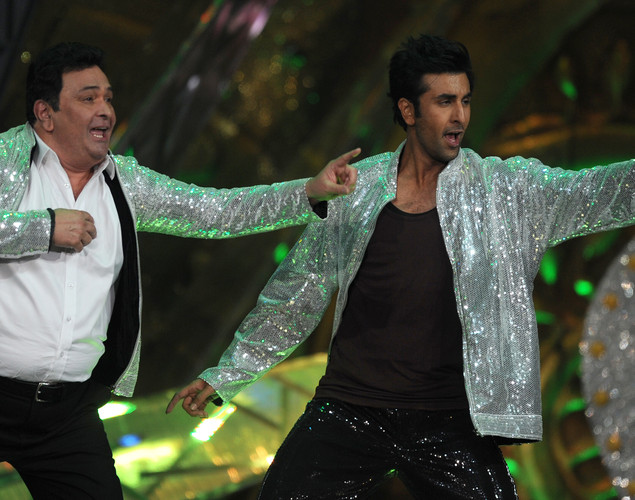 Bollywood actor Ranbir Kapoor (R) performs with his father and veteran actor Rishi Kapoor on the stage during the International Indian Film Academy (IIFA) awards ceremony in Singapore.