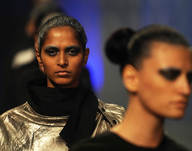 Models showcase creations by Indian designer Kallol Datta during the grand finale of the Lakme Fashion Week (LFW) winter/festive 2012 in Mumbai.