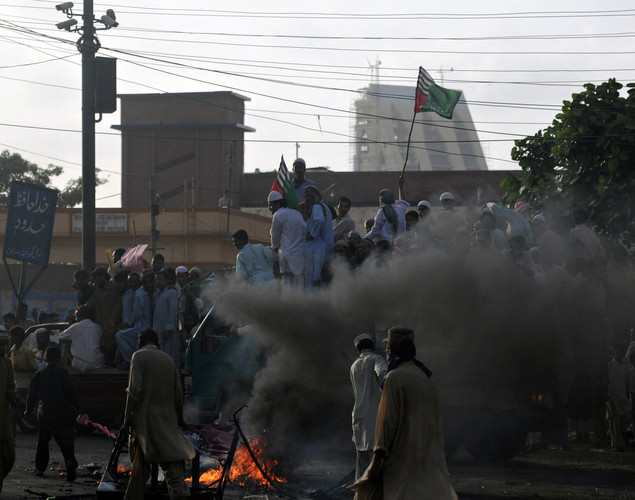 Pakistani Muslim demonstrators march during a protest against an anti-Islam film in Karachi.
