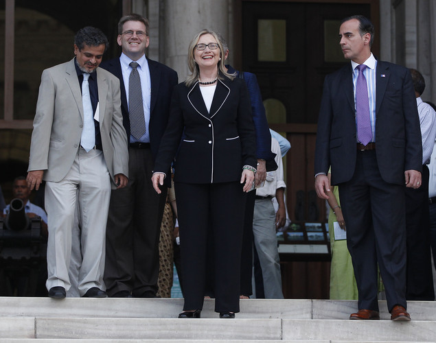 U.S. Secretary of State Hillary Clinton stands (C) on the steps of the Victoria Memorial Hall in Kolkata.