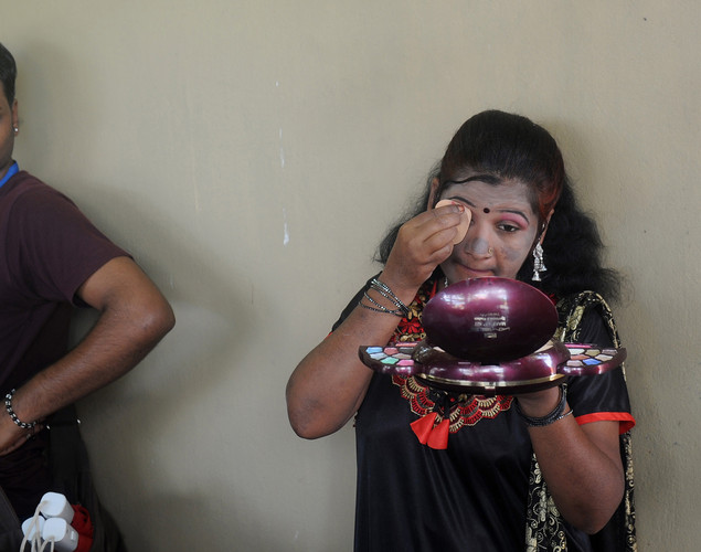 Indian sex workers put on make-up before participating in a drama during the Sex Workers' Freedom Festival in Kolkata.