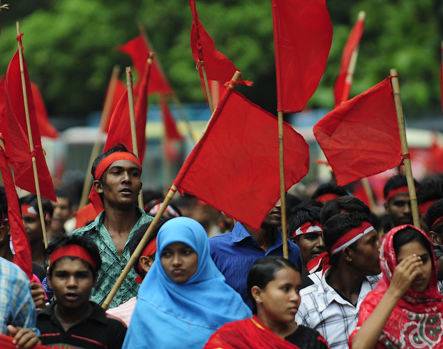 Bangladeshi activists shout slogans and wave flags during a procession to mark May Day or International Workers Day in Dhaka.