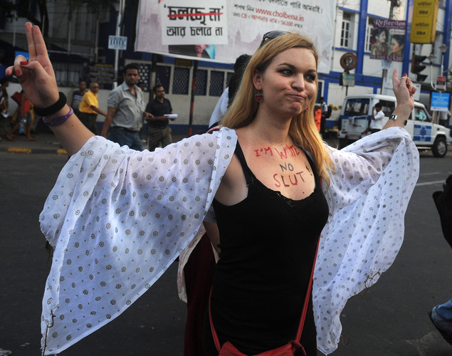 A social activist gestures as she participates in a 'Slut Walk' in Kolkata.