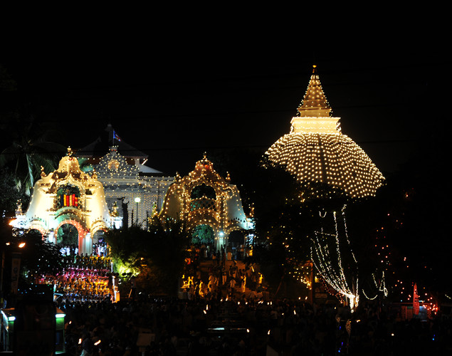 Sri Lanki Buddhist devotees gather around an illuminated temple in Kelaniya on May 5, 2012 during the annual Buddhist festival of Vesak.