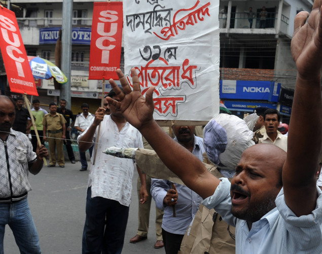 Indian supporters of Socialist Unity Centre of India (SUCI) shout slogans during a nationwide strike in Siliguri.