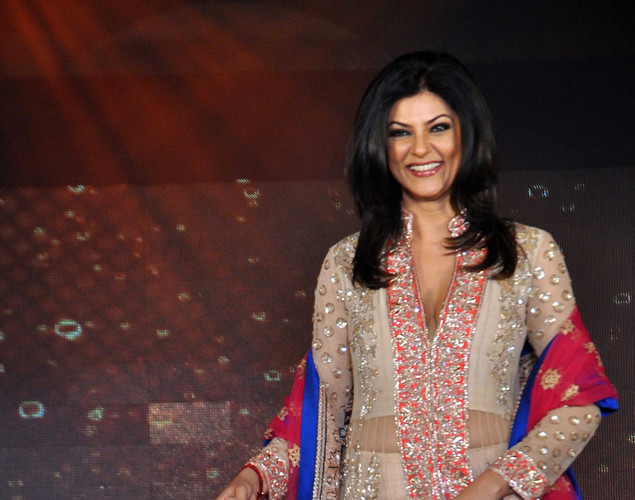 Sushmita Sen walks the ramp displaying creations by designer Manish Malhotra for a public awareness campaign Save and Empower the Girl Child in Mumbai.