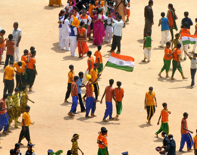 Indian school children attired in taditional costumes walk at the Manek Shaw Parade Grounds during Independence Day celebrations in Bangalore on August 15, 2012.