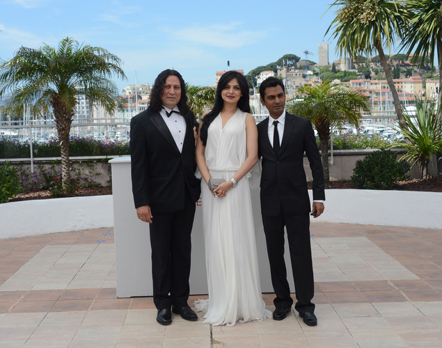 Anil George, Niharika Singh and Nawazuddin Siddiqui pose during the photocall of 'Miss Lovely' presented in the Un Certain Regard selection at the 65th Cannes film festival.