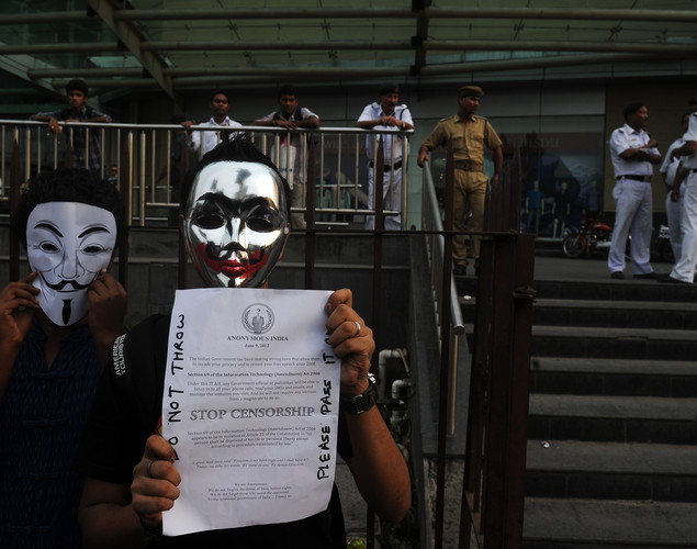 Activists supporting the group Anonymous wear masks as they protest against the Indian Government's increasingly restrictive regulation of the internet outside a shopping mall in Kolkata.