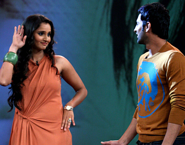 "Indian tennis player Sania Mirza (L) interacts with husband Pakistani cricketer Shoaib Malik on the set of NDTV's television show ""Issi Ka Naam Zindagi"" in Mumbai."