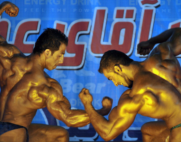 Afghan bodybuilders preform during the Mr. Afghanistan nation wide bodybuilding competition in Kabul. Bodybuilding is one of the country's most popular sports, even permitted during the 1996-2001 Taliban regime.