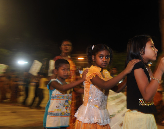 Children of Indian sex workers with their parents march in a May Day rally asking for their rights and the recognition of their profession on the eve of the International Labor Day in Kolkata on late April 30, 2012.