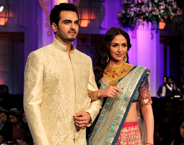 Bollywood actress Esha Deol (R) and her husband Bharat Takhtani showcase a creation by Indian designer Azva on the 4th day of Aamby Valley India Bridal Fashion Week 2012 in Mumbai.