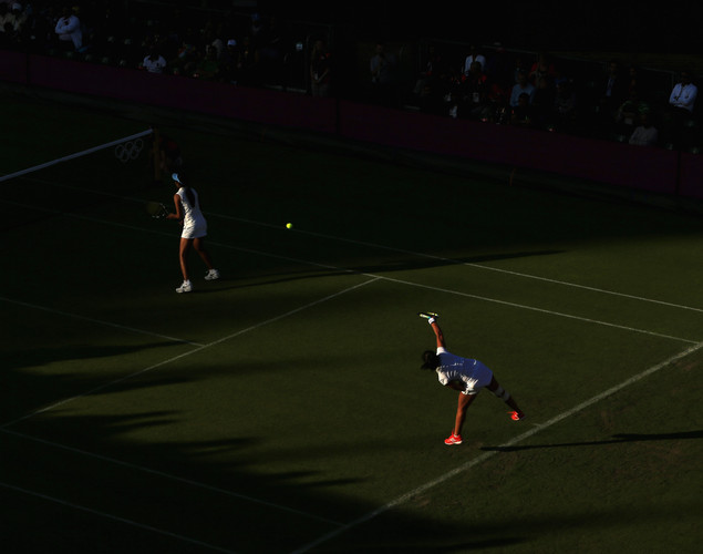 Sania Mirza of India serves during her Women's Doubles match with Rushmion Chakarvarthi against Chia-Jung Chuang and Su-Wei Hsieh of Chinese Taipei on Day 1 of the London 2012 Olympic Games at the All England Lawn Tennis and Croquet Club in Wimbledon on July 28, 2012 in London, England.