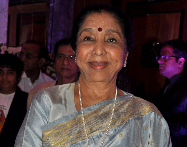 Bollywood playback singer Asha Bhosle attends the wedding reception of playback singer Sunidhi Chauhan and musician Hitesh Sonik.