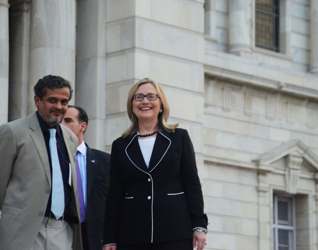 US Secretary of State Hillary Clinton (R) is accompanied by the curator of Victoria Memorial Chittaranjan Panda as she leaves the Victoria Memorial Hall in Kolkata.
