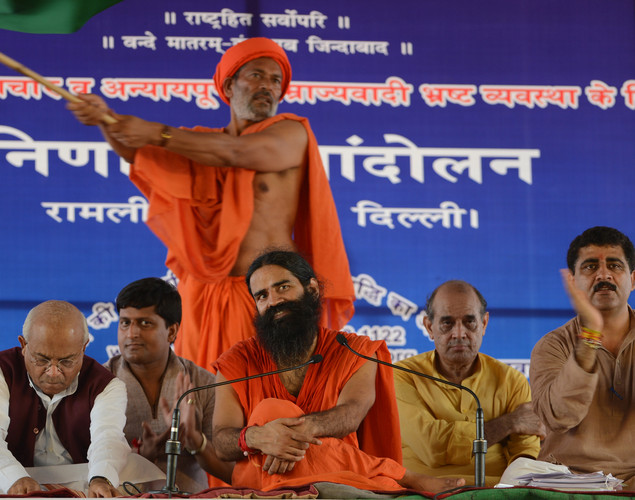 Indian yoga guru Baba Ramdev (C) gestures as he sits during a protest in New Delhi.