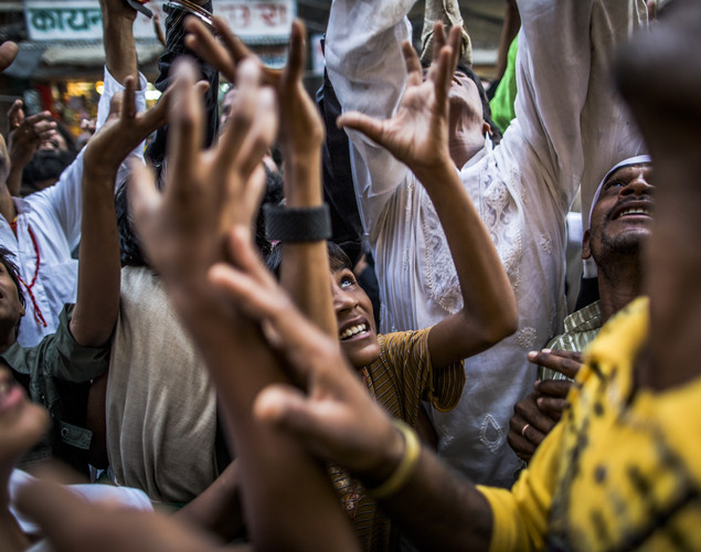 Sufi Muslim pilgrims, reach for alms being thrown from windows, as they march towards the 'durgah' or shrine, where Muhammad Moin-ud-din Chisti is buried, during the annual 'Urs' procession.
