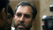 Afridi, lawyer for a Pakistani doctor who helped U.S. officials find al-Qaeda chief Osama bin laden, speaks to the media in Peshawar