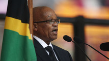 South African president booed at Mandela memorial