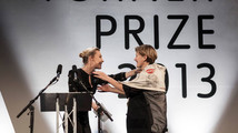French-born film installation artist Laure Prouvost embraces Irish actress Saoirse Ronan after Ronan awarded Prouvost with this year's Turner Prize, in Londonderry, Northern Ireland