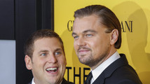 Cast members Leonardo DiCaprio and Jonah Hill arrive for the premiere of the film