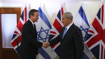 Britain's Cameron puts Iran on guard, sets out support for Israel