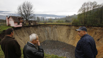 Bosnians panic as sinkhole swallows village pond