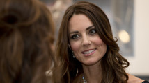 Duchess Kate returns to duties with black tie do