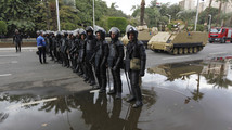 Egyptian security forces hold their positions outside Cairo university during clashes between riot policemen and Cairo University students, supporters of the Muslim Brotherhood and ousted President Mursi, in Cairo