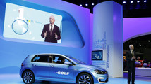 Jonathan Browning introduces the Volkswagen eGolf electric car at the Los Angeles Auto Show in Los Angeles
