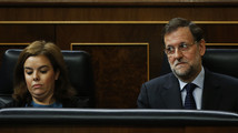 Spanish PM Rajoy and Deputy PM Saenz de Santamaria react during the weekly government control session at Parliament in Madrid