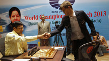 Norway's Carlsen shakes hands with India's Anand before they play during the FIDE World Chess Championship in Chennai