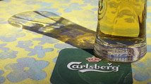Carlsberg's company logo is pictured on a coaster in the bar in Riga